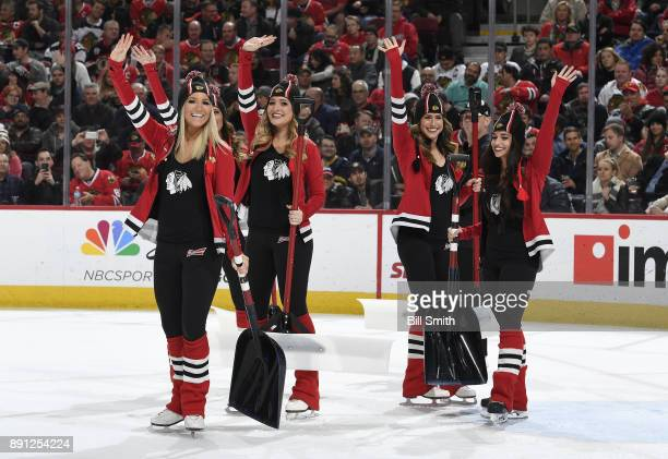 The Chicago Blackhawks icecrew waves to the crowd during the game between the Chicago Blackhawks and the Florida Panthers at the United Center on...