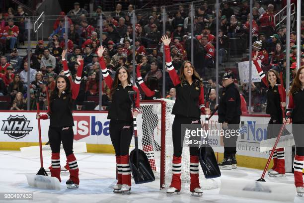 The Chicago Blackhawks icecrew waves to the crowd during the game between the Chicago Blackhawks and the Boston Bruins at the United Center on March...