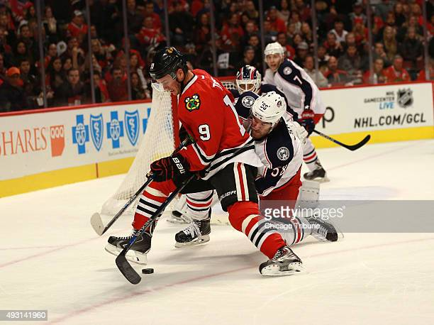 The Chicago Blackhawks' Jonathan Toews and the Columbus Blue Jackets' David Savard battle for the puck during the first period on Saturday Oct 17 at...