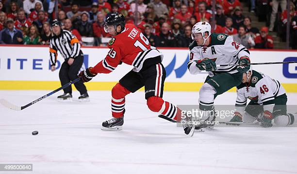 The Chicago Blackhawks' Jonathan Toews puts a shot on goal in the first period against the Minnesota Wild at the United Center in Chicago on Tuesday...