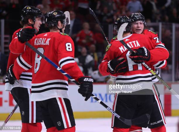 The Chicago Blackhawks' Kirby Dach right receives a hug from teammate Olli Maatta after Dach scored a goal in the first period against the Vegas...