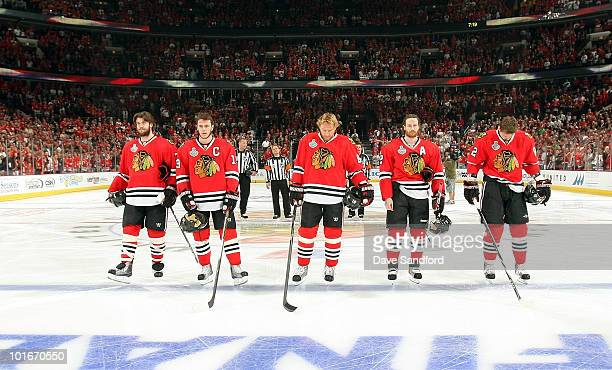 The Chicago Blackhawks line up on the ice for the National Anthem prior to playing in Game Five of the 2010 NHL Stanley Cup Finals against the...