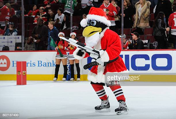 The Chicago Blackhawks mascot 'Tommy Hawk' skates on the ice dressed as Santa during the NHL game between the Chicago Blackhawks and the San Jose...