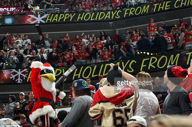 The Chicago Blackhawks mascot 'Tommy Hawk' stands in the crowd dressed as Santa during the NHL game between the Chicago Blackhawks and the San Jose...