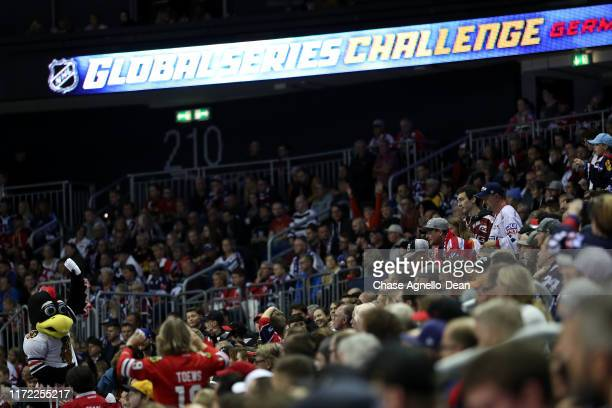 "The Chicago Blackhawks mascot ""Tommy Hawk"" throws t-shirts during the NHL Global Series Challenge 2019 match between Eisbaren Berlin and Chicago..."