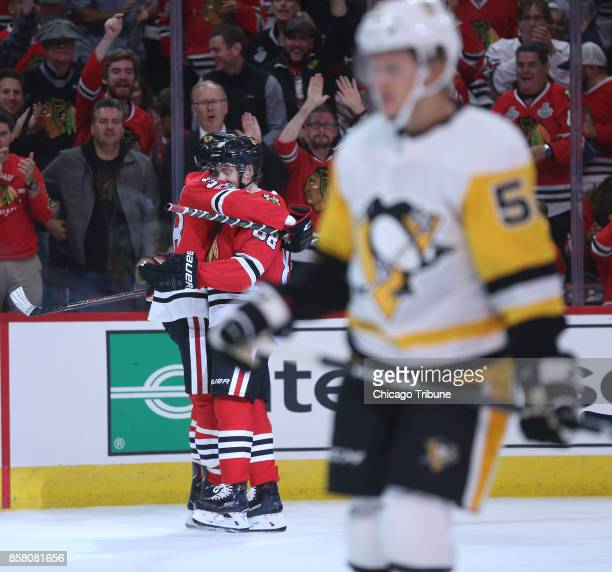 The Chicago Blackhawks' Patrick Kane and Ryan Hartman celebrate after Hartman scores against the Pittsburgh Penguins in the first period at the...