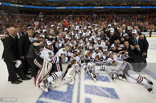The Chicago Blackhawks pose for a photo with the Stanley Cup after defeating the Philadelphia Flyers 43 in overtime at Game Six of the 2010 Stanley...