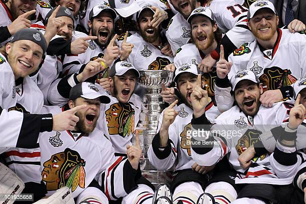 The Chicago Blackhawks pose for a team photo after defeating the Philadelphia Flyers 4-3 in overtime to win the Stanley Cup in Game Six of the 2010...