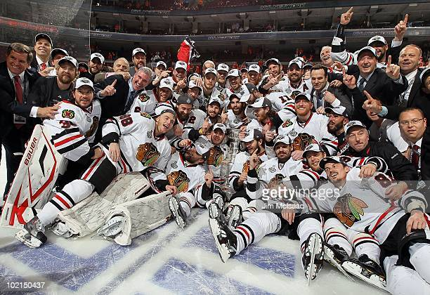 The Chicago Blackhawks pose for a team photo after defeating the Philadelphia Flyers 4-3 in overtime and win the Stanley Cup in Game Six of the 2010...