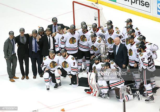 The Chicago Blackhawks pose in front of the Clarence S Campbell Bowl after the Blackhawks 53 victory against the Anaheim Ducks in Game Seven of the...