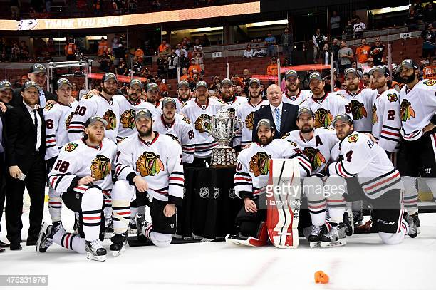 The Chicago Blackhawks pose in front of the Clarence S Campbell Bowl with NHL Deputy Commissioner Bill Daly after the Blackhawks 53 victory against...