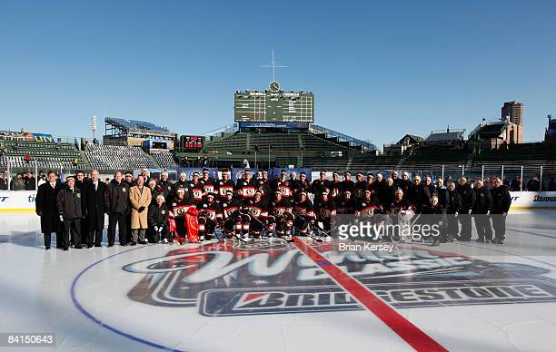 The Chicago Blackhawks pose on the ice during practice a day before playing against the Detroit Red Wings in the NHL Winter Classic at Wrigley Field...