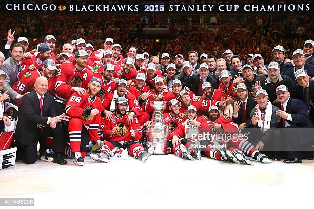 The Chicago Blackhawks pose with the Stanley Cup after defeating the Tampa Bay Lightning by a score of 2-0 in Game Six to win the 2015 NHL Stanley...