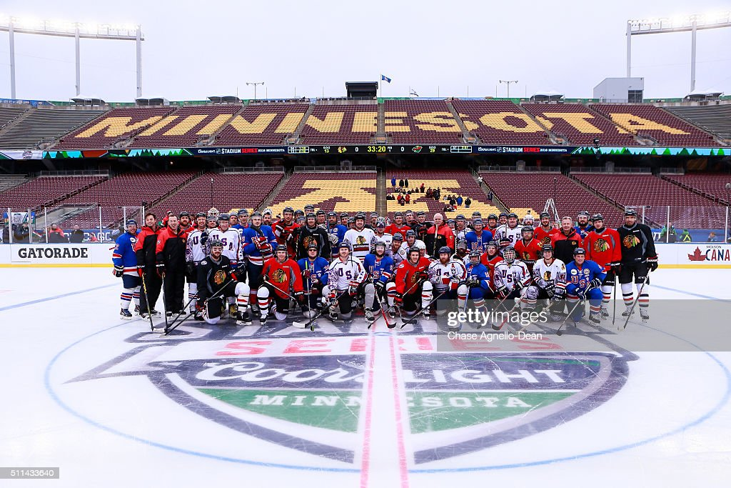 The Chicago Blackhawks pose with the Wounded Warrior hockey team during practice day for the 2016 Coors Light Stadium Series game against the Minnesota Wild at TCF Bank Stadium on February 20, 2016 in Minneapolis, Minnesota.