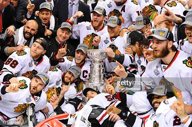 The Chicago Blackhawks poses with the Stanley Cup after the win against the Boston Bruins in Game Six of the Stanley Cup Final at TD Garden on June...
