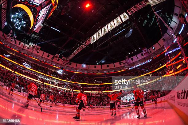The Chicago Blackhawks skate during pregame ceremonies of the NHL game against the Nashville Predators at the United Center on February 25 2016 in...