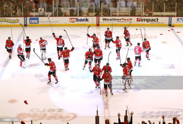 The Chicago Blackhawks skate to center ice to acknowledge the fans after defeating the Los Angeles Kings 4-2 in Game Two of the Western Conference...