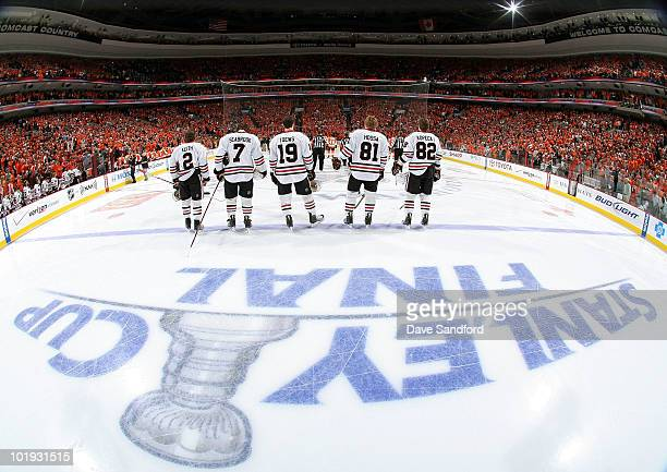 The Chicago Blackhawks stand on the ice during the National Anthem before taking on the Philadelphia Flyers in Game Six of the 2010 NHL Stanley Cup...