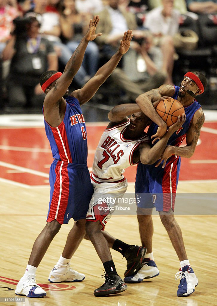 The Chicago Bulls' Ben Gordon gets fouled by Detroit Pistons' Richard Hamilton, as Flip Murray guards on the play during action in Game 4 of the NBA Eastern Conference semi-finals. The Bulls defeated the Pistons, 102-87, at the United Center in Chicago, Illinois, Sunday, May 13, 2007.