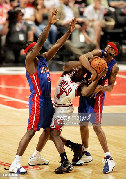 The Chicago Bulls' Ben Gordon gets fouled by Detroit Pistons' Richard Hamilton as Flip Murray guards on the play during action in Game 4 of the NBA...