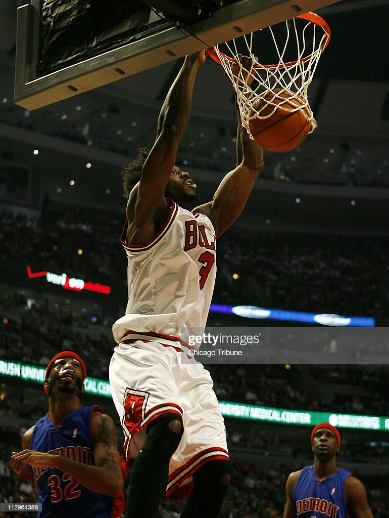 The Chicago Bulls' Ben Wallace dunks in front of Detroit Pistons guard Richard Hamilton in the first half of Game 4 of the Eastern Conference semi-finals at the United Center in Chicago, Illinois. Sunday, May 13, 2007.