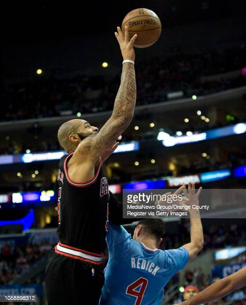 The Chicago Bulls' Carlos Boozer shoots over the Clippers' JJ Redick at Staples Center in Los Angeles CA on November 24 2013 The Clippers won 12182