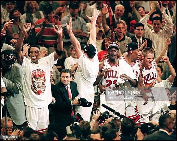 The Chicago Bulls celebrate 13 June after game six of the 1997 NBA Finals at the United Center in Chicago Illinois Michael Jordan was named the...