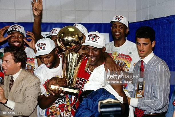 The Chicago Bulls celebrate after winning the 1993 NBA Championship Finals Series against the Phoenix Suns at America West Arena on June 20 1993 in...