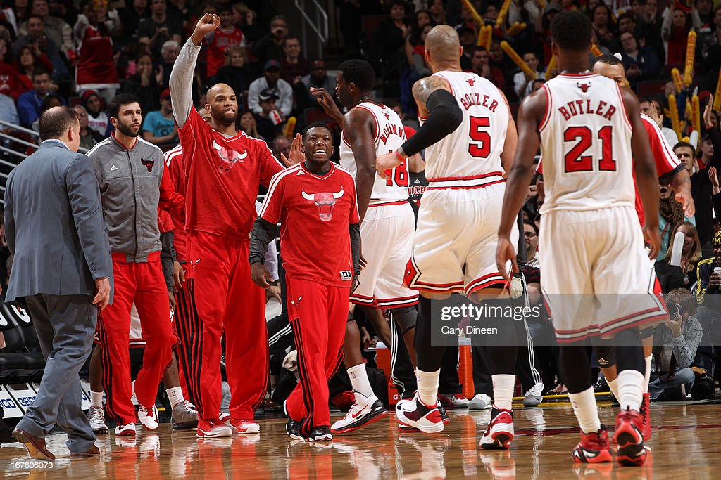 The Chicago Bulls celebrate on the bench during the game against the Detroit Pistons on March 31, 2013 at the United Center in Chicago, Illinois.