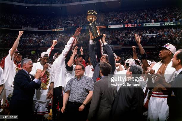 The Chicago Bulls celebrate winning the NBA Championship after defeating the Seattle SuperSonics in game six of the 1996 NBA Finals played June 16...