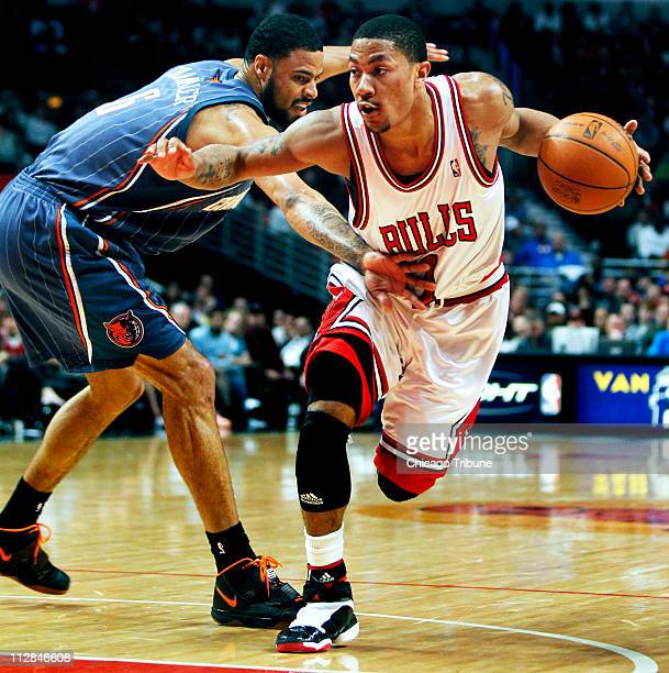ff6a09f58a82 The Chicago Bulls  Derrick Rose drives against the Charlotte Bobcats  Tyson  Chandler in the