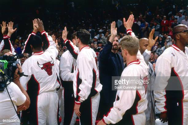 The Chicago Bulls high five each other before the game against the Indiana Pacers on April 20 1996 at the United Center in Chicago Illiniois NOTE TO...