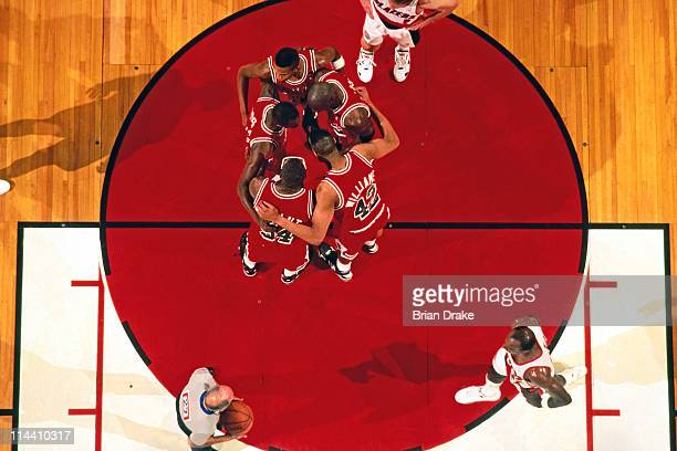 The Chicago Bulls huddle against the Portland Trailblazers at the Veterans Memorial Coliseum in Portland Oregon circa 1992 NOTE TO USER User...