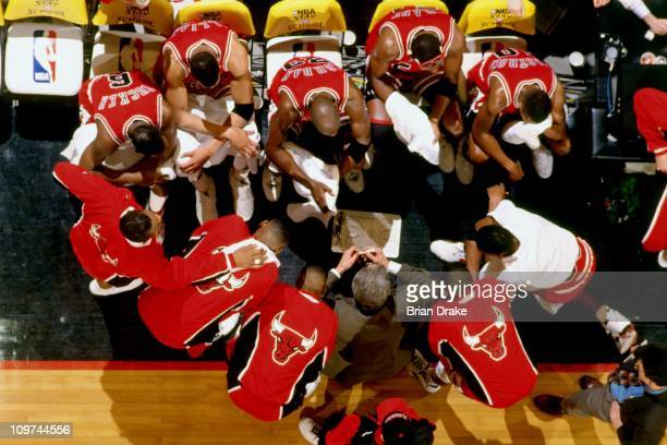 The Chicago Bulls huddle against the the Portland Trailblazers during a game played circa 1993 at Memorial Coliseum in Portland Oregon NOTE TO USER...