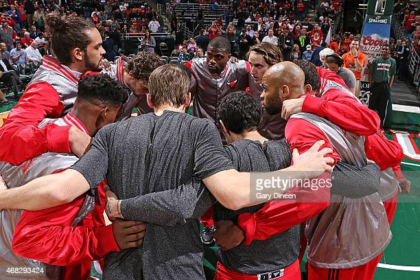 The Chicago Bulls huddle before the game against the Milwaukee Bucks on April 1 2015 at the BMO Harris Bradley Center in Milwaukee Wisconsin NOTE TO...