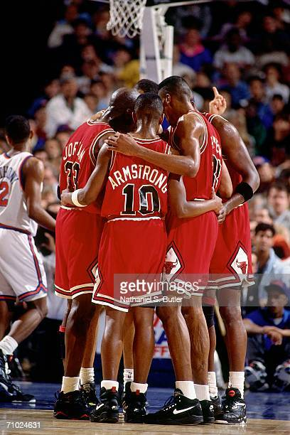 The Chicago Bulls huddle up against the New York Knicks during Game Three of the Eastern Conference Semifinals during the 1992 NBA Playoffs at...