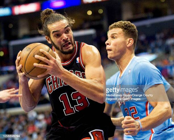 The Chicago Bulls' Joakim Noah tries to get around the Clippers' Blake Griffin at Staples Center in Los Angeles CA on November 24 2013 The Clippers...