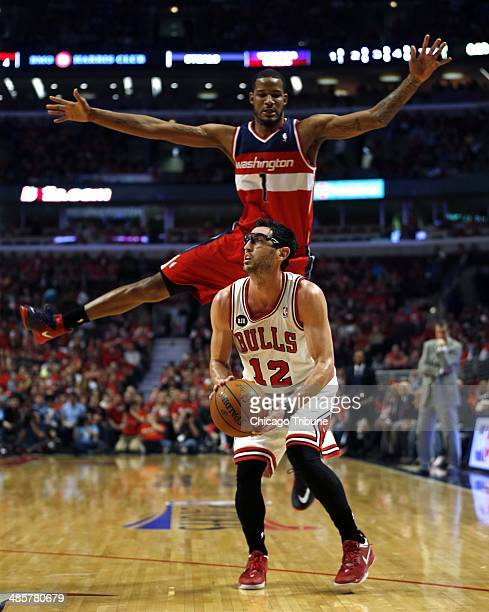 The Chicago Bulls' Kirk Hinrich pump fakes Washington Wizards' Trevor Ariza in the first quarter of Game 1 of the NBA Eastern Conference...