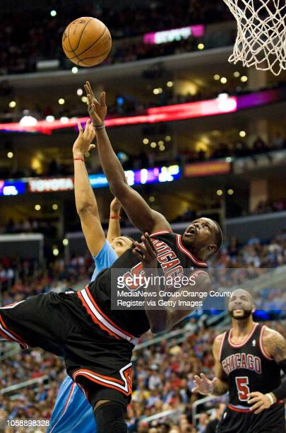 The Chicago Bulls' Luol Deng takes an offbalance shot in front of the Clippers' Ryan Hollins at Staples Center in Los Angeles CA on November 24 2013...