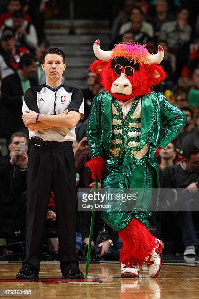 The Chicago Bulls mascot 'Benny the Bull' stands next to NBA official Pat Fraher during the game against the Oklahoma City Thunder on March 17 2014...