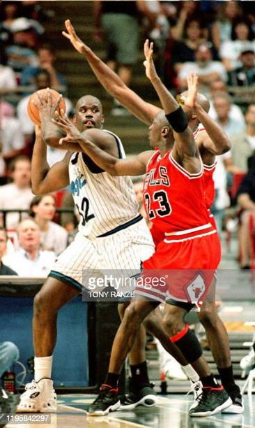 The Chicago Bulls Michael Jordan and John Salley guard the Orlando Magic's Shaquille O'Neal during game four of the eastern conference finals 25 May...