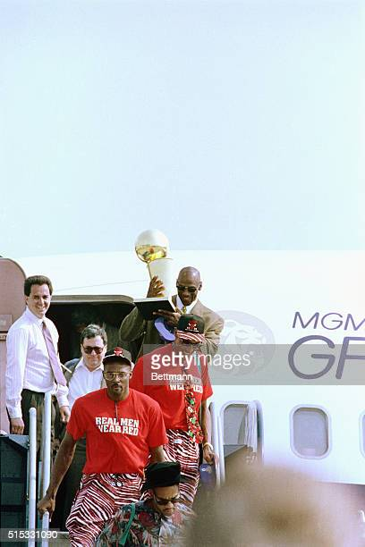 The Chicago Bulls' returned to the city as NBA Champions 6/13 greeted by an enthusiastic crowd Bulls' Horace Grant and Scottie Pippen lead the way...