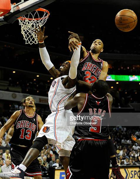 The Chicago Bulls' Taj Gibson blocks the shot of the Charlotte Bobcats' Gerald Wallace during the first half of NBA action at Time Warner Cable Arena...