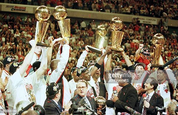 The Chicago Bulls team celebrate with their five Larry O'Brien finals' trophies they have won over the last seven years 13 June after beating the...