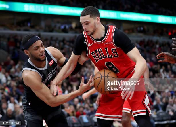 The Chicago Bullsapos Zach LaVine is hit in the stomach by the ball while battling for possession with the Detroit Pistonsapos Bruce Brown in the...