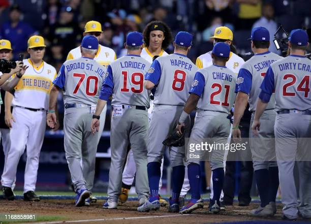 The Chicago Cubs and the Pittsburgh Pirates shake hands after the MLB Little League Classic at Bowman Field on August 18 2019 in Williamsport...