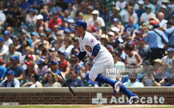 The Chicago Cubs' Anthony Rizzo drops the bat after hitting an RBI single against the Minnesota Twins in the third inning at Wrigley Field in Chicago...