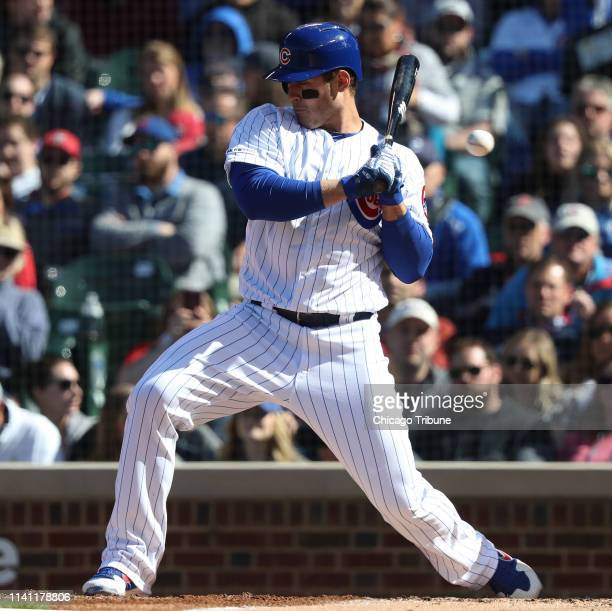 The Chicago Cubs' Anthony Rizzo flinches at a high pitch from St Louis Cardinals starting pitcher Michael Wacha in the third inning at Wrigley Field...