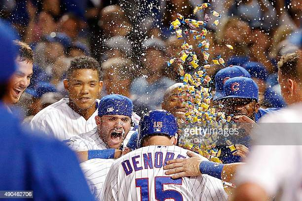 The Chicago Cubs celebrate a walkoff home run by Chris Denorfia of the Chicago Cubs against the Kansas City Royals at Wrigley Field on September 28...