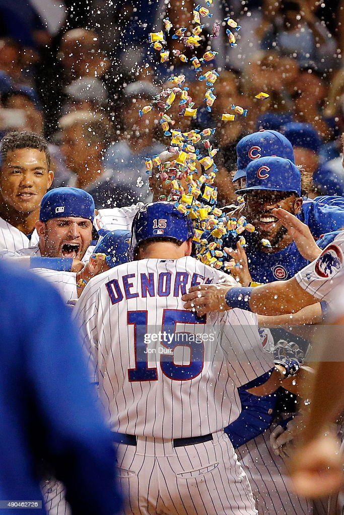 The Chicago Cubs celebrate a walk-off home run by Chris Denorfia #15 of the Chicago Cubs against the Kansas City Royals at Wrigley Field on September 28, 2015 in Chicago, Illinois. The Chicago Cubs won 1-0 in eleven innings.